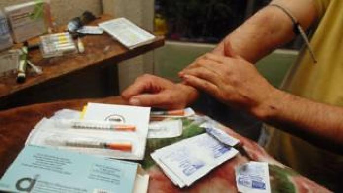Registered heroin addict injects prescription medication