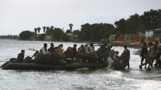 A dingy filled with migrants arriving in Kos in 2015