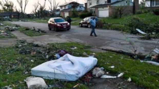 Residents of Trotwood, Ohio, inspect storm damage on Tuesday morning