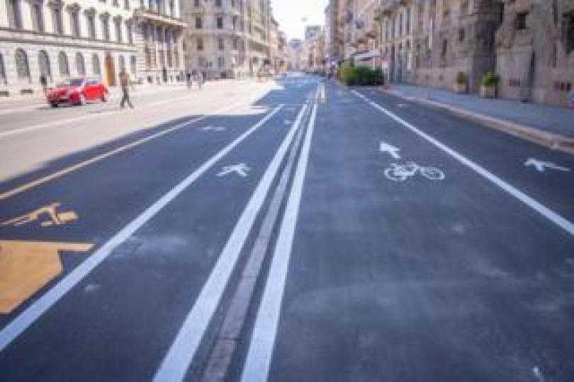 A new scheme in Milan re-allocated car parking space for pedestrians and cyclists