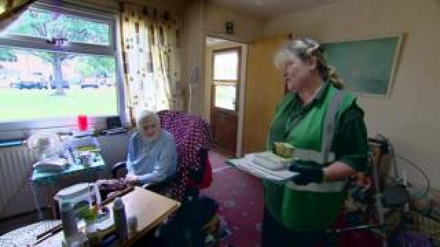 Social care worker with elderly woman