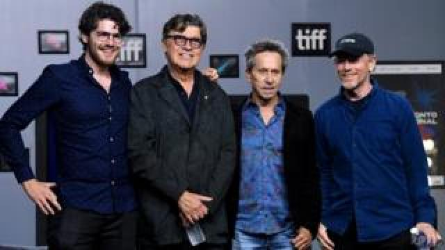 Daniel Roher, Robbie Robertson, and exec producers Brian Grazer and Ron Howard