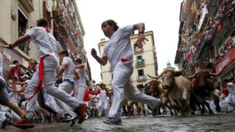Runners flee from bulls during the San Fermín festival in Pamplona July 2018