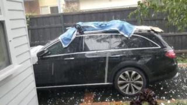 Parked cars hit by hail stones in Melbourne