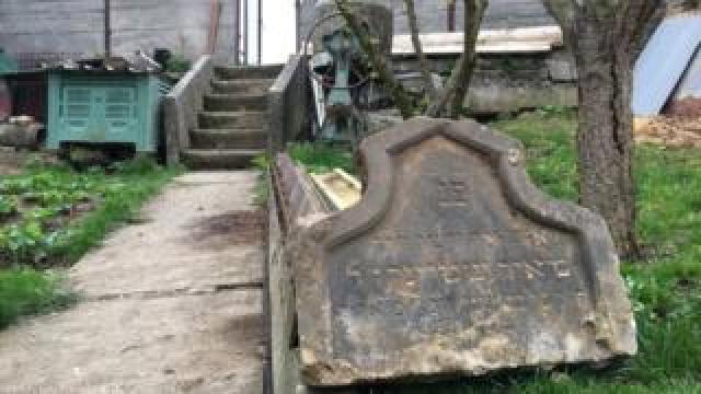 A tombstone lying in a garden in Prostejov