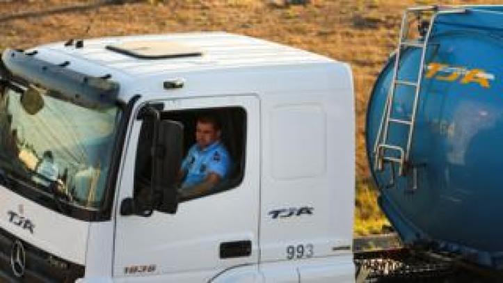 Policeman driving tanker truck, 12 Aug 19