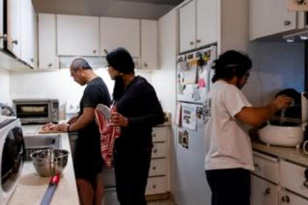 Miguel's family cooks in the kitchen