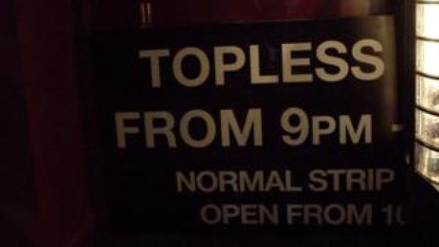 Sign at lap dancing club