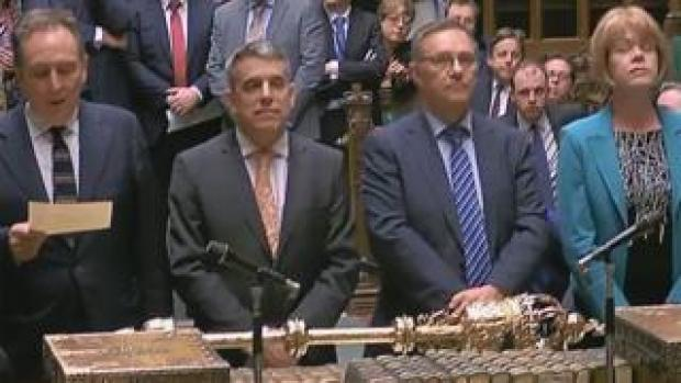 Tellers deliver the result of the vote in the Commons