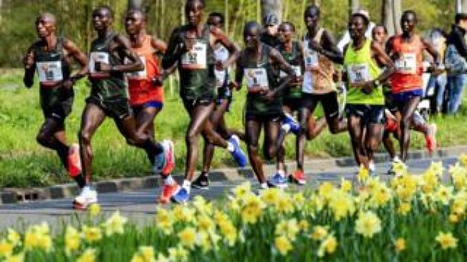 Marius Kipserem (R) of Kenya runs past daffodils as he competes in the 39th Rotterdam Marathon in Rotterdam, the Netherlands - Sunday 7 April 2019