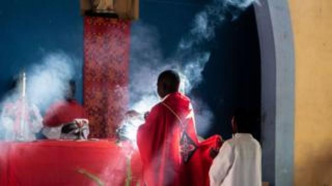 Priest burning incense at a church - Sunday 14 April 2019