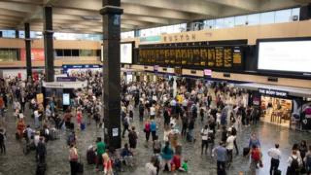 Interior view of the main concourse full of commuters and people travelling from Euston Railway Station in London in July 2018.