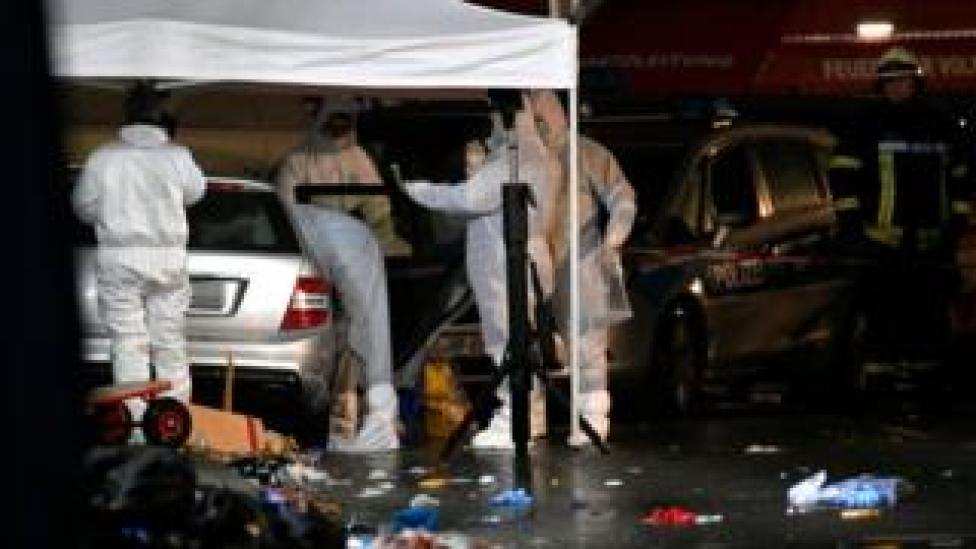 Forensics teams examine a car in the German town of Volkmarsen