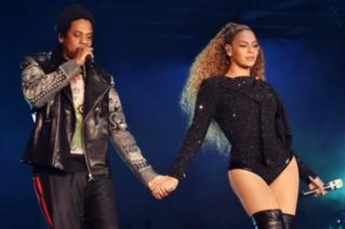 Jay-Z and Beyonce Knowles perform on stage during the 'On the Run II' tour opener in Cardiff, Wales