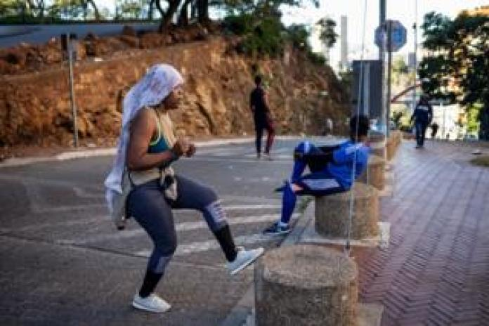 Woman training on the street