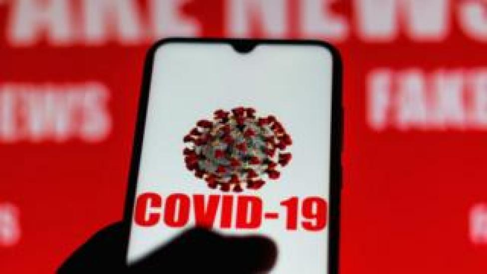 Phone screen with Covid-19 symbol showing