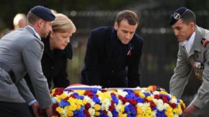 German Chancellor Angela Merkel and French President Emmanuel Macron lay a floral wreath as they take part in a French-German ceremony in the clearing of Rethondes (the Glade of the Armistice) in Compiegne, northern France, 10 November 2018