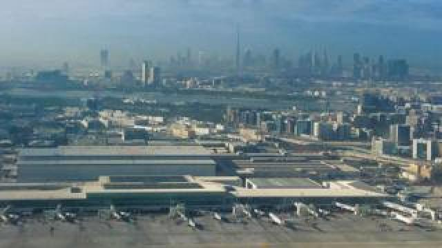 View of Dubai airport with city in background