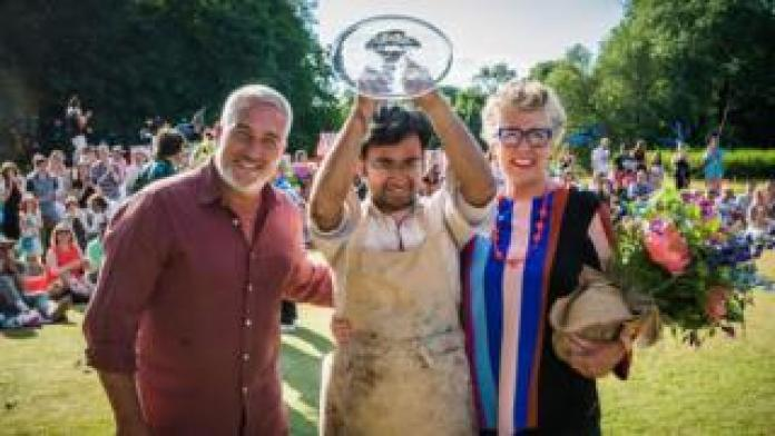 Rahul Mandal (centre) is crowned champion by judges Paul Hollywood (left) and Prue Leith (right)