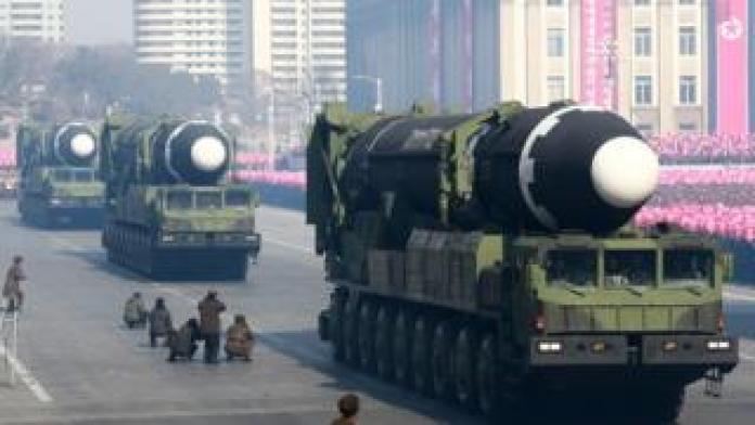 North Korean missiles on trucks.