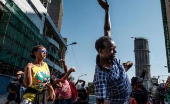People take part in an exercise on a street in Addis Ababa on Car Free Day, 3 February