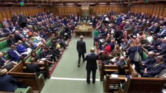 MPs take their seats for the opening of Parliament