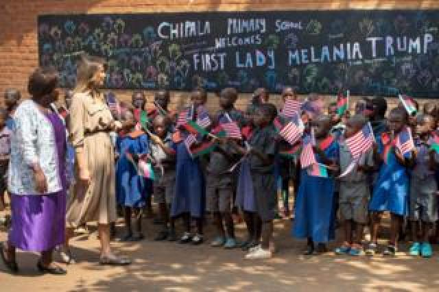 US First Lady Melania Trump (2nd L) visits Chipala Primary School alongside head teacher Maureen Masi (L) on October 4, 2018 during a 1-day visit in Malawi, part of her week long trip to Africa to promote her 'Be Best' campaign.