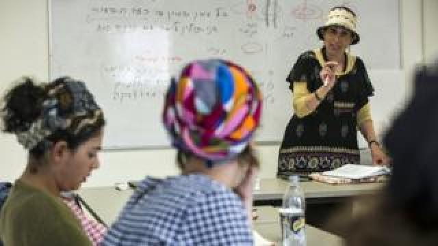 Shani Taragin, 45, a women's health and Jewish law teacher during a class at the Matan Women's Institute for Torah Studies in Raanana, Israel on April 30,2019. (Photo by Heidi Levine for BBC)