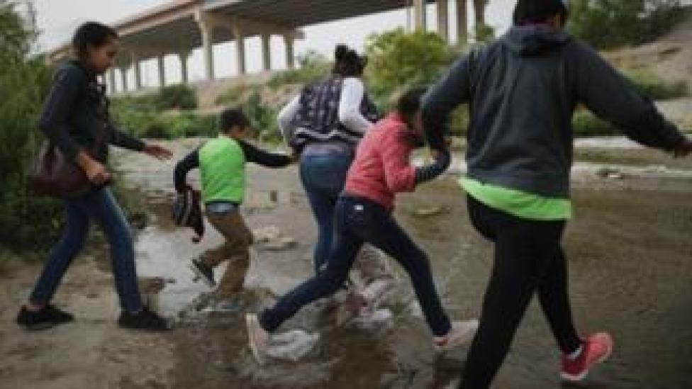 Migrants enter Texas through the US-Mexico border