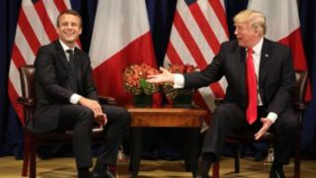In this file photo taken on September 18, 2017 Franch President Emmanuel Macron (L) laughs with US President Donald Trump before a meeting at the Palace Hotel during the 72nd session of the United Nations General Assembly in New York.