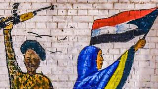Graffiti of an armed member of the security forces in Sudan and a female protester