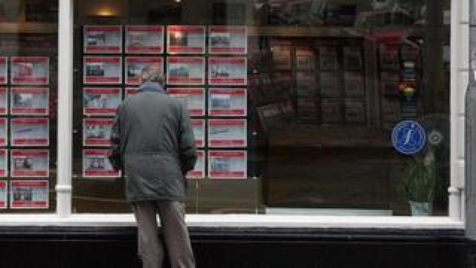 older man looking at an estate agency