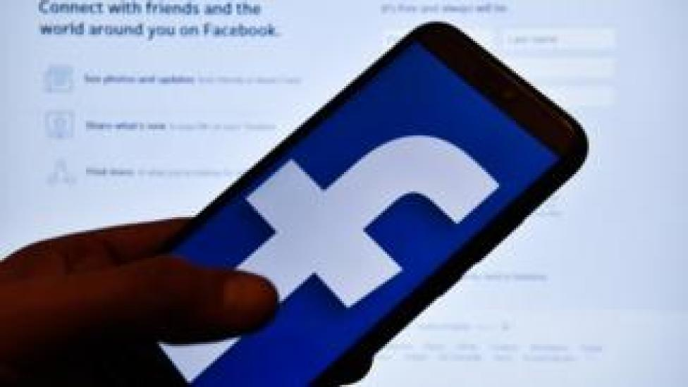 In this photo illustration a Facebook logo seen displayed on a smartphone.