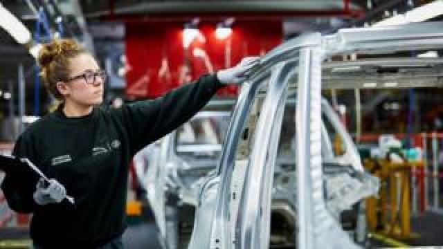 Car worker in factory