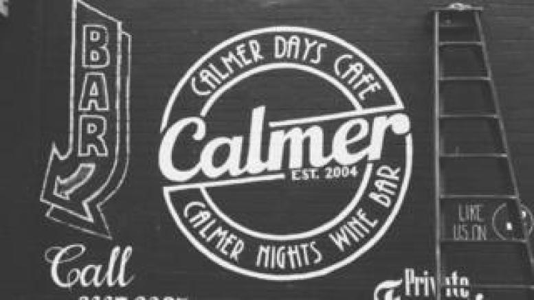 Cafe branding on the wall outside The Calmer Cafe