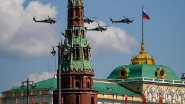 Russian helicopters fly past the Kremlin