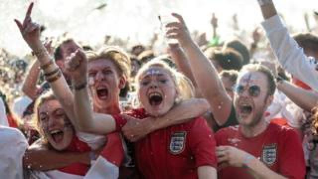 England fans celebrating the team's performance in the World Cup