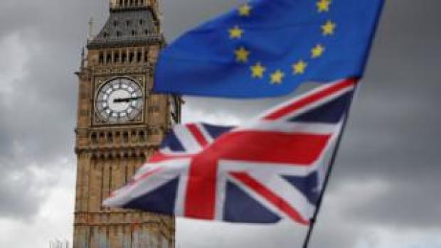 The Union Jack and European Union flags fly near Big Ben