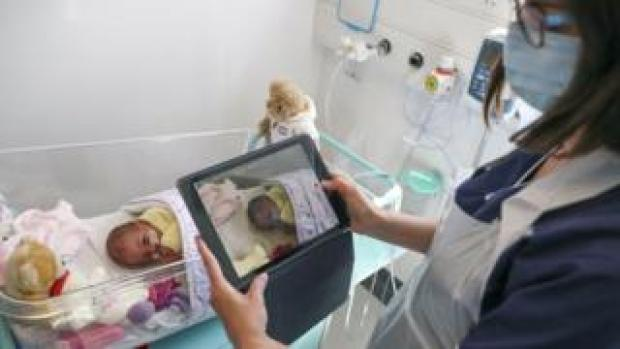Baby being filmed on an iPad in May 2020