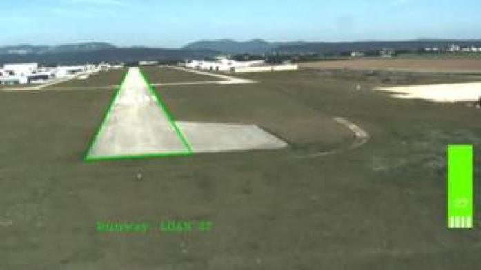 A computer pilot's view of the runway on approach