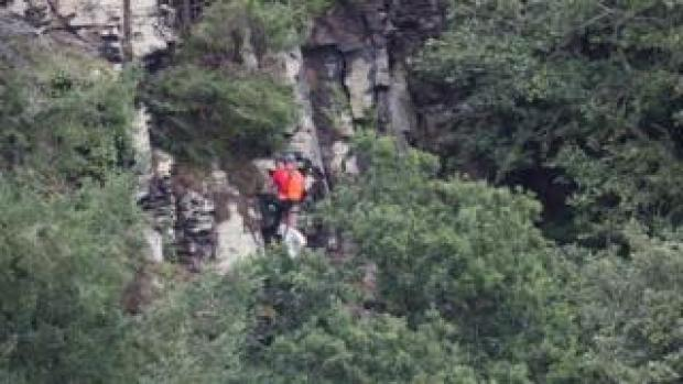 Rescuer on cliff