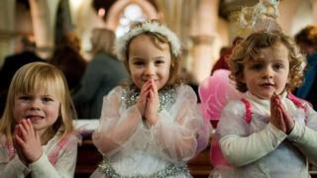 Angels wait for their cue during a traditional Christmas Nativity