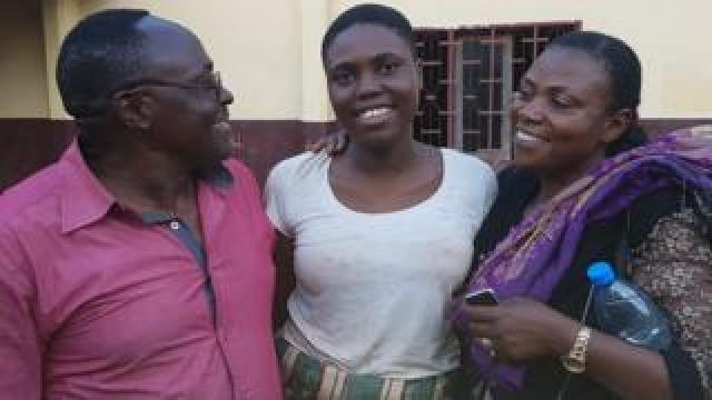 Daughter hugging her parents