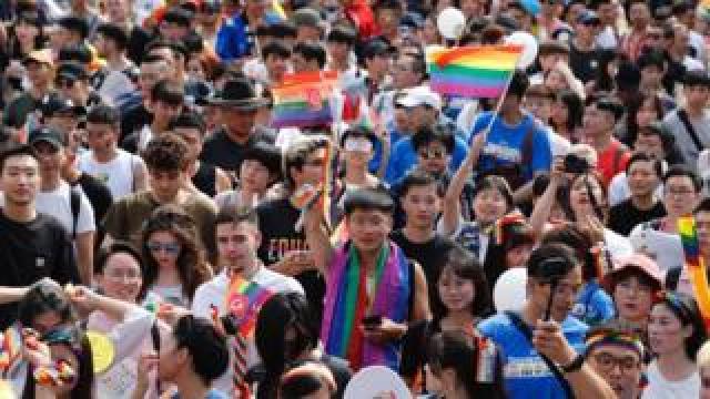 People participate in the annual Taipei Pride march in Taipei