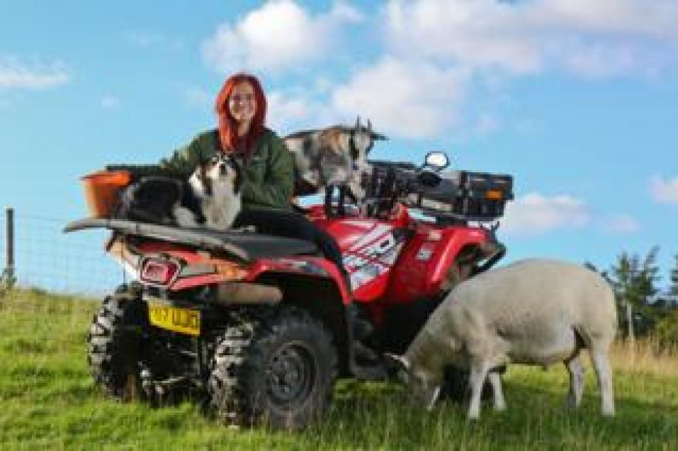 Hannah and some of her animals on her farm