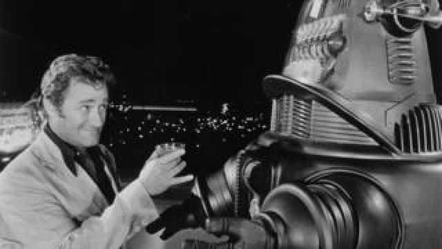 Dick Miller toasting a robot in Hollywood Boulevard