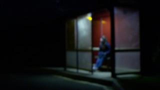 girl in bus stop