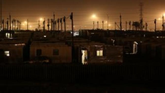Power lines pictured at night in Khayelitsha township, South Africa - Tuesday 10 July 2018