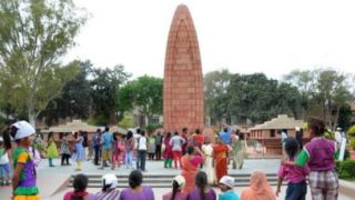 Indian visitors gather near the Jallianwala Bagh Martyrs' Memorial in Amritsar