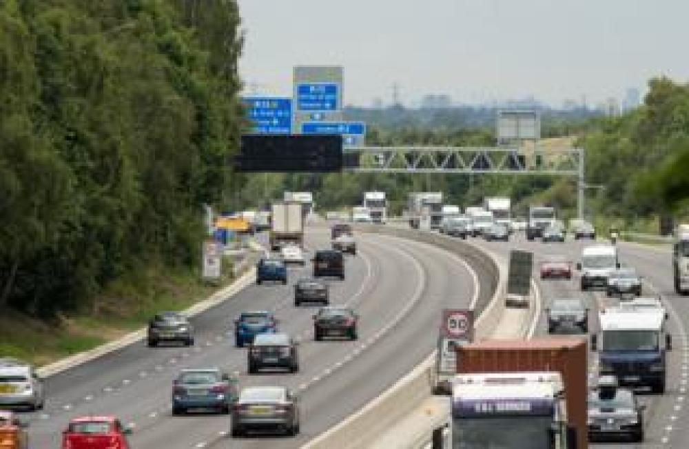 Cars drive on a motorway